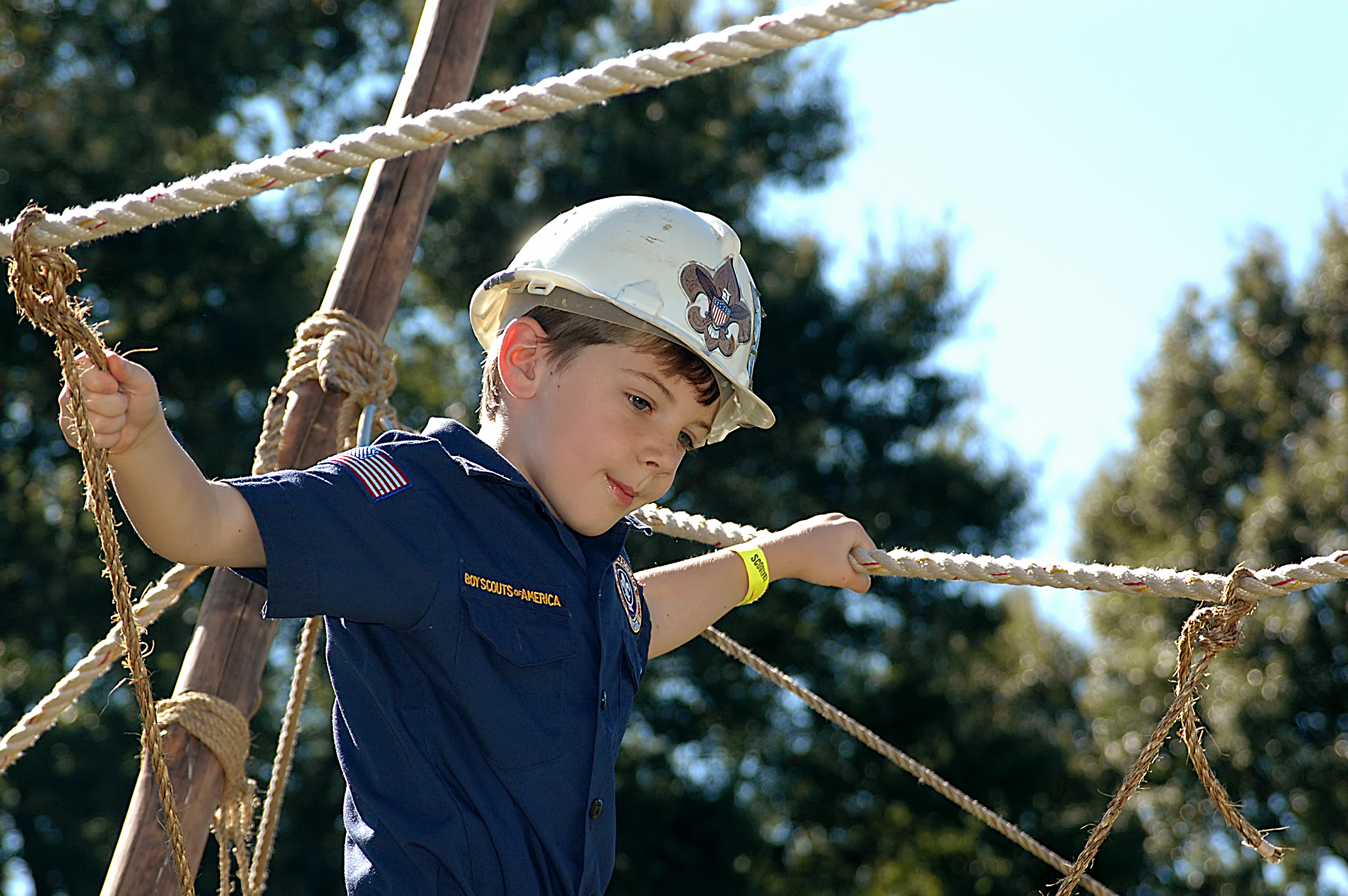 A Cub Scout crosses a bridge