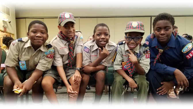 Four Scouts in the Scoutreach program