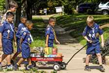Scouts help each other deliver popcorn