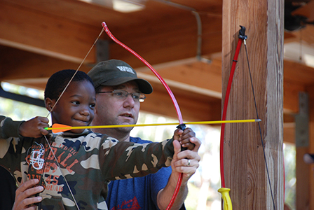 A Scout learns how to hold a bow