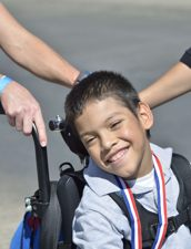 Champion in wheelchair.
