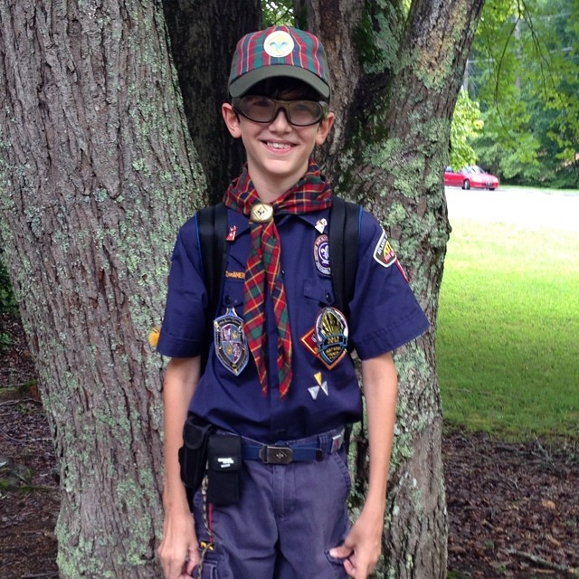 A Cub Scout is prepared