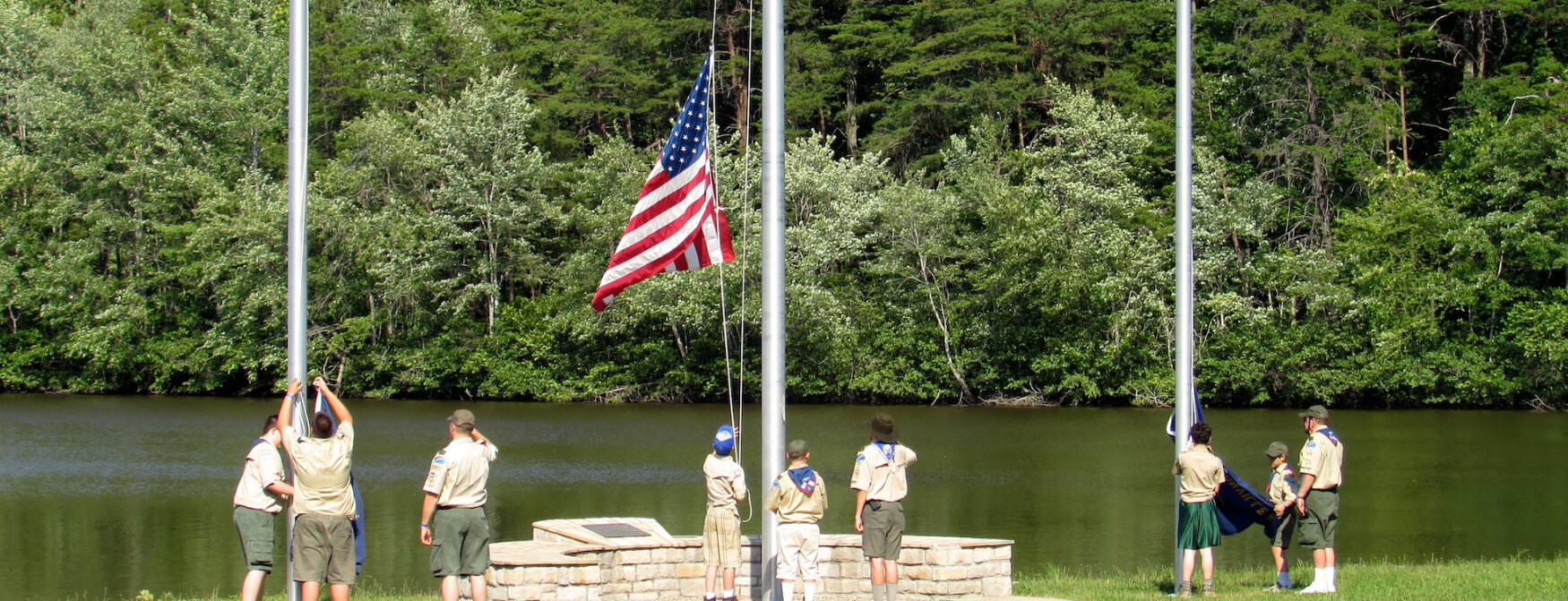Scouts raise the flags at Camp McKee